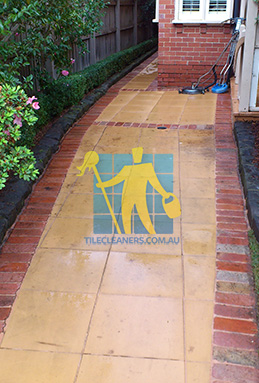 outdoor sandstone tiles pavers wet from cleaning with quarry tiles around Canberra